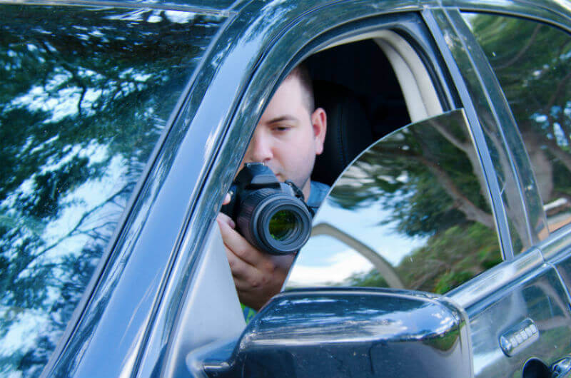 Private Investigator in car