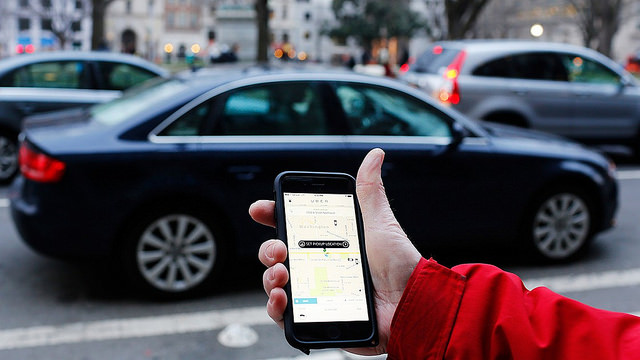 A smartphone is used to locate an Uber taxi.