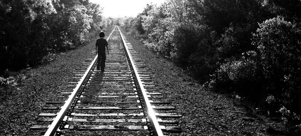 Child on train tracks